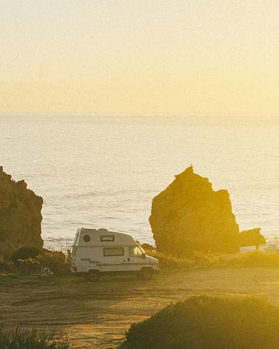nature white motorhome near cliff during daytime van