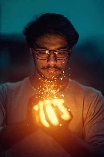 people man holding lighted art human