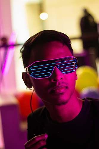 human man in black crew neck shirt and LED sunglasses sunglasses