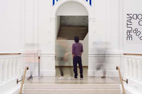 human man standing on door people