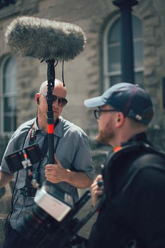 human men getting ready to shoot a movie film people
