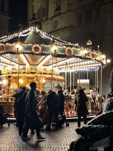 human people near horse carousel carousel