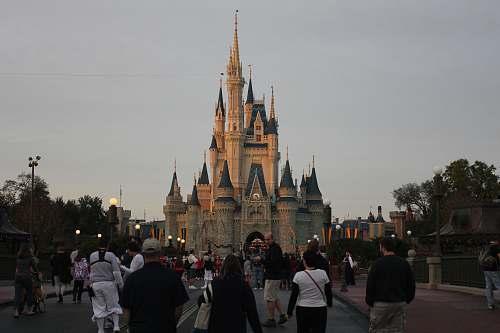 human people walking towards castle pedestrian