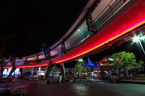 human red neon lights lining the building magic kingdom