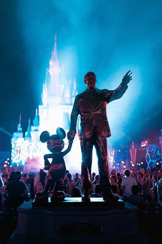 people Walt Disney and Mickey Mouse statue during daytime human