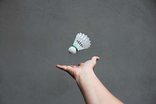 human white badminton shuttlecock sport
