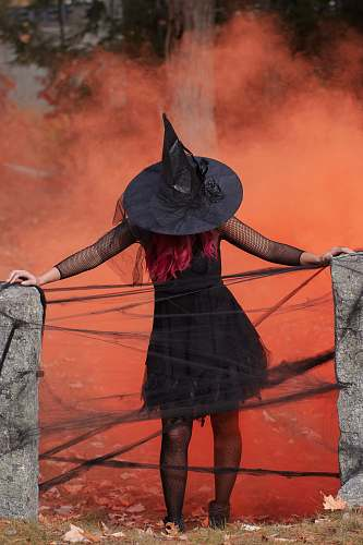 apparel witch holding two black post clothing