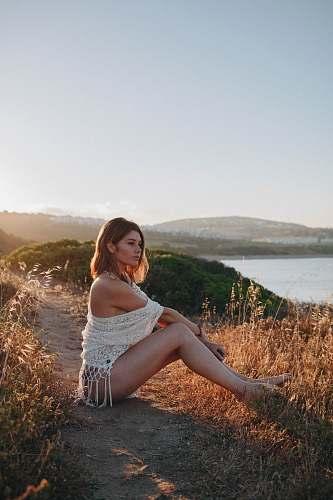 apparel woman sitting near river clothing
