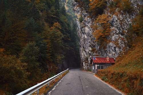 road gray asphalt road in between rock mountains cliff