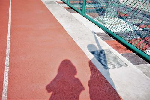premiere two person's shadow on brown and red surface red carpet