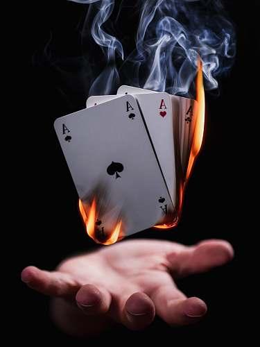 germany burning playing cards person