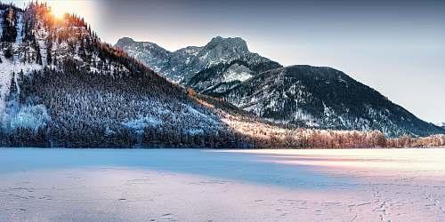 mountain mountain range and snowy field photo ice