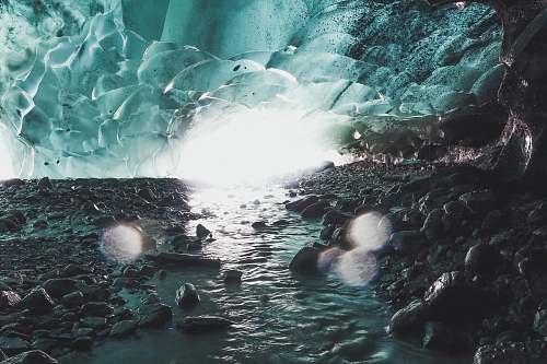 ice rock monolith and body of water digital wallpaper glacier