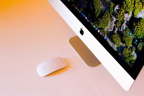 south africa turned-on silver iMac beside Apple Magic Mouse mouse