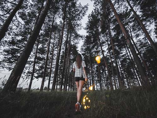 russia woman walking in forest forest