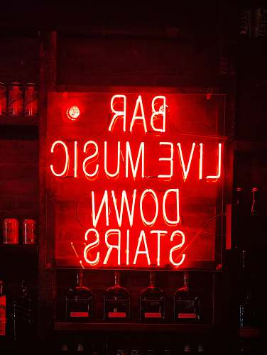 liquor bar live music down stairs neon light signage drink