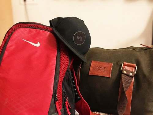 clothing black cap on duffle bags bag
