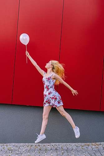 clothing woman holding white balloon person