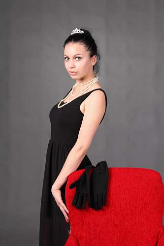 clothing woman standing beside chair fashion