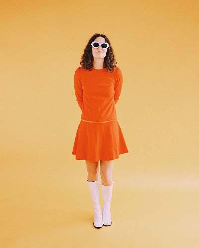 clothing woman wearing orange long-sleeved dress dress