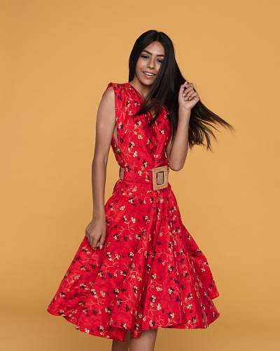 clothing woman wearing red floral sleeveless midi dress dress