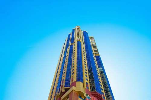 sky blue and beige high-rise building skyscraper