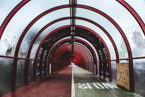 glasgow empty red and white glass tunnel building