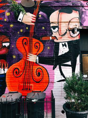 graffiti man holding double bass wall art plant