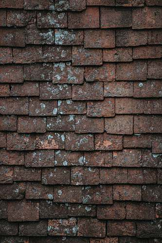 grunge closeup photography of brown and gray concrete bricks pattern
