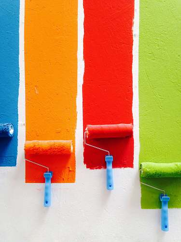 paint four orange, green, blue, and red paint rollers color