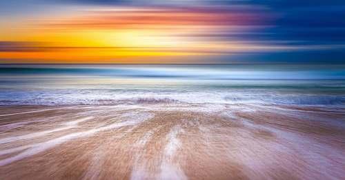 ocean shallow focus photography of coast sea