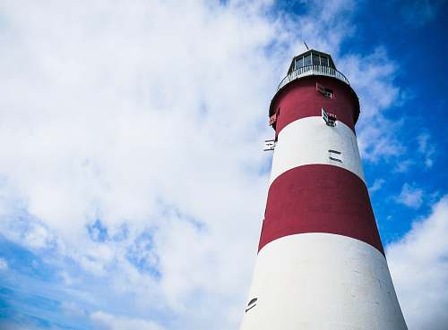 photo lighthouse red and white lighthouse under cloudy blue sky tower free for commercial use images