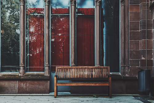 germany empty brown wooden bench near shop window