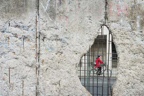 germany woman riding bicycle hole