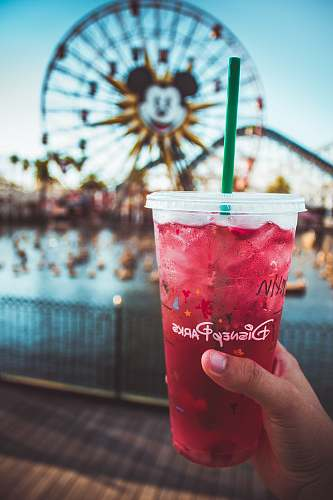drink pink Disney Paris drink with green straw person