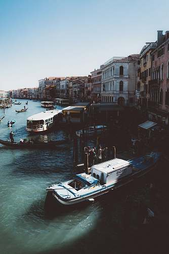 venice aerial view photography of motorboats near establishments italy