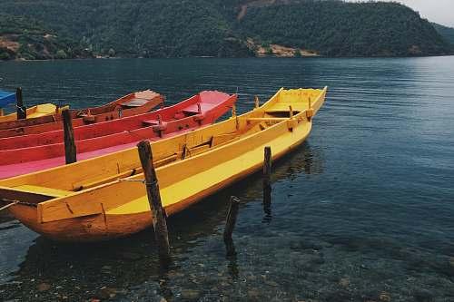 transportation boats near seashore during daytime vessel