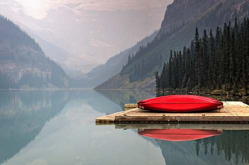 canoe brown floater with red canoe in body of water lake louise