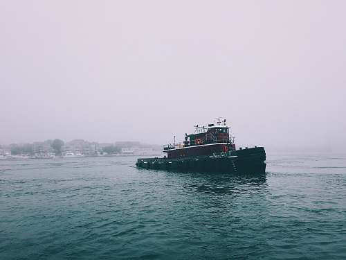 tugboat red and black boat on sea water ship
