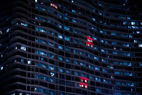 night low-angle photo of high rise building window
