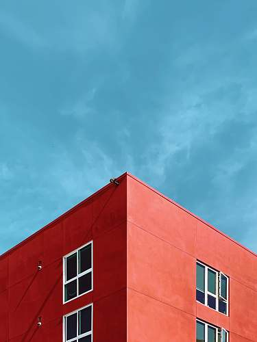 architecture photo of rooftop of red building sky