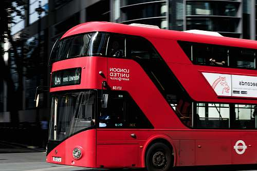 photo transportation red and black bus near building vehicle free for commercial use images