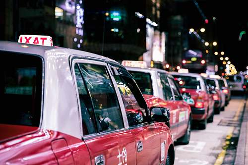 photo car red taxis on road during nighttime taxi free for commercial use images