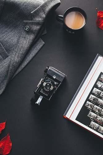 flaylay black film camera near gray suit jacket vintage