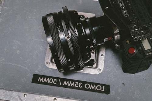 lens black Lomo DSLR camera on gray floor surface vintage glass