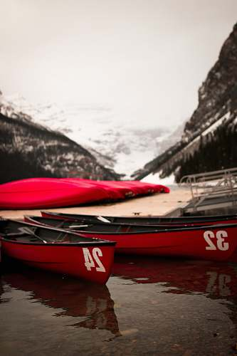 watercraft two red row boats boat