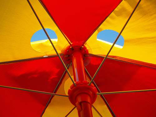 umbrella red and white parasol umbrella blue sky red yellow food