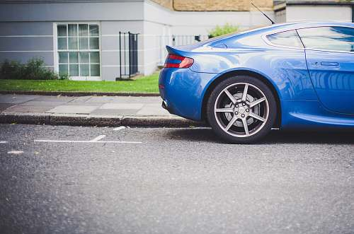 vehicle blue coupe parked in front of house sports car