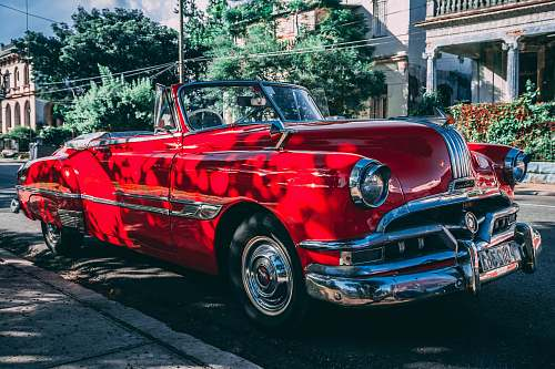 photo cuba classic red convertible coupe parked beside road havana free for commercial use images