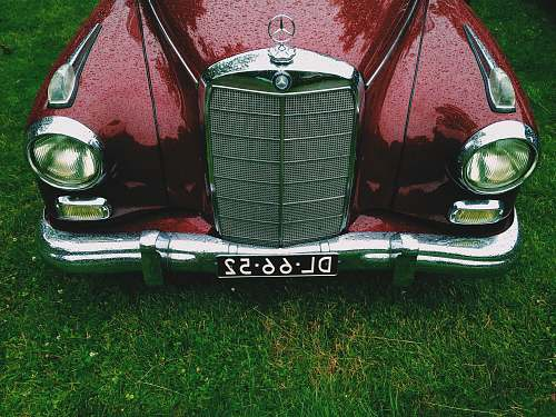 bumper classic red Mercedes-Benz car with DL6652 license plate oldtimer